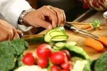 fotolia 2206111Chef cutting vegetables